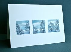 One Layer—SU Stamps: Lovely as a Tree.  Created a mask by punching three squares into grid paper, which allowed for even spacing. Placed the card underneath, sponged the clouds and stamped the trees.  Best left without any sentiment.