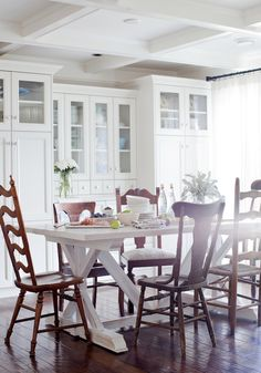 Love the mismatched antique chairs with a big white farmhouse table