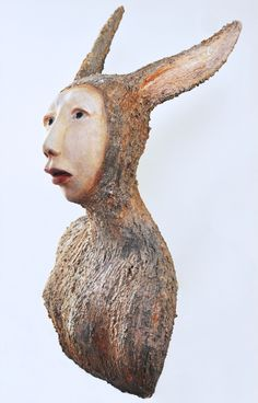 """Rabbit Girl"" by Elizabeth Ostrander. Ceramic, Acrylic and Vintage Glass Doll Eyes. 18"" x 12"" x 13"" Available at www.maine-art.com"
