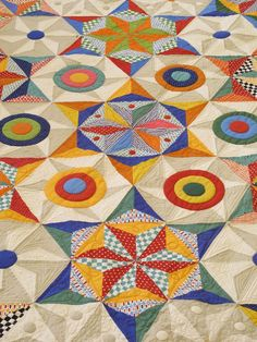 """Sandy's """"Flying Circles Pattern."""" Most of the fabrics are from Sandy's Pindot and Pezzy Prints collection. Such a vivid imagination. You can check out many of our other patterns from American Jane by clicking here."""