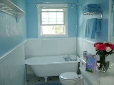 Small BlueWhite Bathroom with Clawfoot tub We found an old