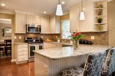 kitchen ideas with white cabinets Kitchen Transitional with beadboard peninsula ceramic tile