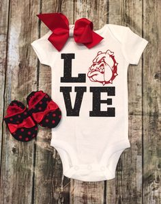 Sadie Mae will need this to cheer on big sister Addy during basketball season .. Long sleeve Bulldog Onesie, Baby Girl Football Onesie, Georgia Bulldogs  Shirt, Sparkle Football Onesie, Onesie For Baby Girls by BellaPiccoli on Etsy https://www.etsy.com/listing/286136847/georgia-bulldog-onesie-baby-girl