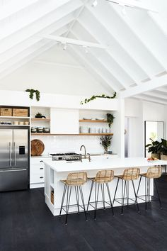 Black kitchen floors, white vaulted ceilings