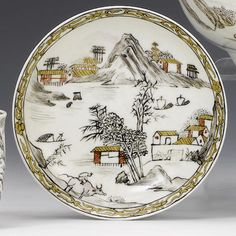 A rare Worcester saucer circa 1765 Pencilled in black and heightened in red enamel and gilding with an extensive Chinese landscape including a series of buildings, sampans on a river and a boy on a buffalo in the foreground, 11.8cm diam FOOTNOTES Provenance: the Zorensky Collection, part 1, lot 53. This was probably made as a direct replacement for a Chinese prototype.