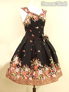 Strawberry Rose Garden (INNOCENT WORLD)  The contrast and how the floral elements outline the dress. <3