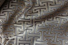 """Description Gold and silver Geometric pattern reminiscent of an """"Aztec"""" design; both modern and elegant with a subtle sheen making."""