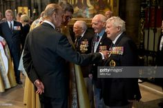 Prince Philip, Duke of Edinburgh points at the medals of veteran Donald Hunter, a radio operator in World War II and founder of the Normandy Merchant Navy Memorial Trust, as they talk at the end of a service of thanksgiving to mark the VE Day 70th Anniversary at Westminster Abbey on May 10, 2015 in London, England. (Photo by Matt Dunham - WPA Pool/Getty Images)