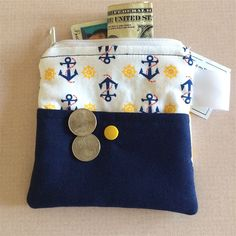 Women's Nautical Fabric Wallet Zipper Purse Credit Card Holder. Quality handmade FABRIC ZIPPER PURSE designed with premium quilt shop fabrics. This small fabric wallet has been created with fleece interfacing to hold its shape and also with woven interfacing for strength and durability. Nautical anchors and ships wheels accent this cute purse organizer. Inside is secure section with zipper closure. Outside has Kam snap on a 3/4 high pocket with cutest little red fish swimming around. This...