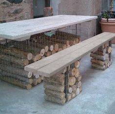 """""""Gabion Table and Bench by Rebecca Cole Firewood as patio furniture"""" Posted by Julie Carlson © Remodelista, LLC (quote) via remodelista.com"""