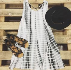 You will never want to wear another dress again. This trapeze dress with round neck and deep v-back with criss cross detail will have you in love! A sleeveless dress with an all over tie dye, gauzy fa