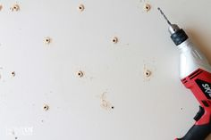 Drill holes in the headboard