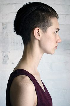 androgynous, slicked back hair, shaved back and sides