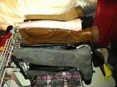 Closet organization! Use pant hangers with clips to hang your boots so they don't flop over!