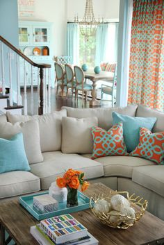 This is a very modern color scheme: Soft beige and baby blue are the two main, classical colors but the orange accents update the look. Gold is the 'surrpise' color.