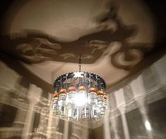 Motorcycle shadow Bottle Light chandelier by NunnikhovenArtStone
