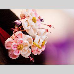 Gorgeous plum blossom kanzashi worn by maiko Katsune