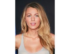 Blake Lively: tan skin, pink cheeks, thick black liner, beachy hair from bun