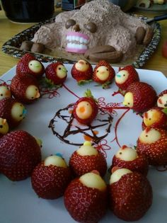 """I feel the urgent need to share this terrifying sloth cake (with strawberry disciples—they're """"offering a sacrificial victim to their hungry sloth god"""") with you"""