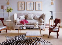 Gorgeous, eclectic space: love the layered rugs, the sofa, and the gold accents throughout. Elle Decor.