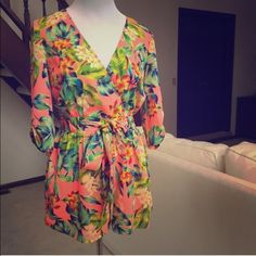 NWT Gianni binni neon pink romper Super cute romper! I bought off of here in the wrong size! Hoping to sell fast so I can buy an XS!! Love love love this! Super cute and so flattering. Great way to show off nice tan skin this upcoming summer! You'll love it! Retails for 109$ Gianni Bini Dresses Mini