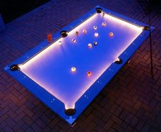 Outdoor Pool Table Features Built-In Lighting For Nighttime Play. I'm wondering if we could revamp an old pool table & just buy a set of the glowing balls from a billiards company.