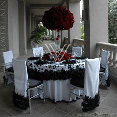 Lilypad White with Black Floral (Black Feather Trim Optional), Matte Satin White Underlinen, Shantung Black Napkin, Custom Matte Satin White Chair Sleeves with Black Feather Trim to match)