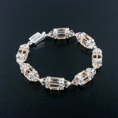 Try this champagne-pink hue for a beautiful accent with subdued color.  This bracelet is handmade with Swarovski crystals and finished with a fancy box clasp.  Made in USA.