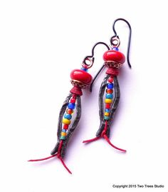 Vivid Catch: These petite, lightweight earrings are a lot of colorful whimsy in a small package...shaped like a fish!  By Two Trees Studio.