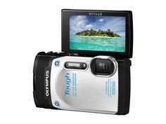 Olympus Stylus TG-850 IHS 16 MP Digital Camera (White) - International Version. Tough performance; shockproof to 7 feet, waterproof to 33 feet; crushproof to 220 lbs, freezeproof to 14 degrees F. Newly developed 21mm (equiv.), 5X zoom lens, the widest in the compact camera class. The first Tough series camera equipped with a tilt LCD screen. Art Filters.