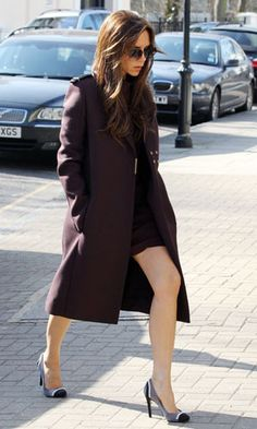 Stepping out in London, Victoria Beckham worked one of her favourite looks from her own collection - a burgundy military style double-breasted coat. Matched perfectly to her wine-hued shift dress - also from her own line, the designer accessorised with cool square sunnies and neat toe-cap pumps.