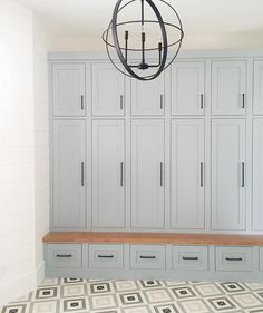 Mudroom. Soft gray paint and cement tile.