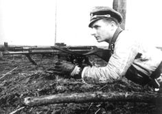 SS-Untersturmführer Léon Gillis from the Wallonien Division scans for enemy forces in Pomerania in the spring of 1945. He is armed with a StG 44 assault rifle.