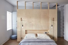 A Brooklyn brownstone features a DIY plywood headboard with a low recessed shelf, perfect for stashing current reads. See In Bed-Stuy, Brooklyn, a Renovated Brownstone with Inspired Solutions. Photograph by Jonathan Hokklo. Headboard Wall, Headboards For Beds, Interior, Home, Home Bedroom, Bedroom Design, House Interior, Bedroom Wall, Build A Closet
