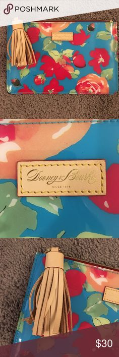 Dooney & Bourke Plastic Floral Clutch Pouch Beautiful Dooney & Bourke Plastic Floral Clutch Pouch. Brand-new and has never been used. H- 6 L- 9 Dooney & Bourke Bags Clutches & Wristlets