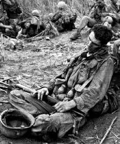 A weary soldier from the 101st Airborne Division rests after fighting their way out of nearly complete encirclement by North Vietnamese forces during Operation Hawthorne, Dak To, South Vietnam, June, 1966