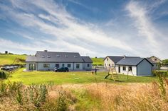 The site Keith and Romina McGreal chose to build on required an Environmental Impact Statement to secure planning permission. Modern Bungalow, Bungalow House Design, House Designs Ireland, County Mayo, Bungalow Exterior, Planning Permission, Cool Websites, Cabin, Mansions