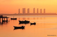 Golden haze lingers above Tang island Bay in Qingdao city, eastern Shandong Province.