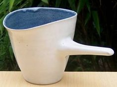 Side handled stoneware pouring vessel with Lucie Rie and Hans Coper seals to the base.