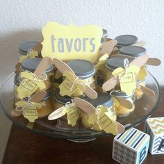 favors for baby shower yellow and gray - Use baby food jars and fill with lemon drops or yellow bath salts. Spray paint top of lids only gray.