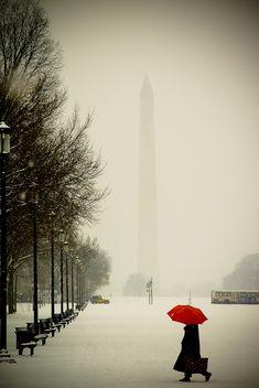 snow at the washington monument, washington, dc....wonder if the umbrella figure is photoshopped?