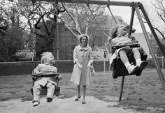 Joan Kennedy, wife of Sen. Edward Kennedy (D-Mass.) swings daughter Kara, 3, and son Ted, Jr., 19 months, during an excursion to a public park near their Georgetown home, May 5, 1963.
