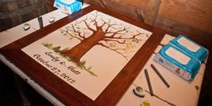 """If you want to give your guests a chance to create something a little more unusual, consider one of the following guestbook alternatives. Read http://weddings.gatheringguide.com/ac/diy-wedding-tips/wedding-guestbook-alternatives - Photo: Matt Costa / Guestbook Art: Emily Costa, with the article """"Wedding Guestbook Alternatives"""". #wedding #guestbook #thumbprint #tree"""