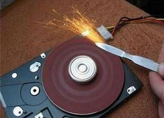 for Legacy Computers. Recycled computer parts. An old hard drive with some sand paper on it, used as a knife sharpenerRecycled computer parts. An old hard drive with some sand paper on it, used as a knife sharpener Cool Tools, Diy Tools, Disco Duro, Old Computers, Homemade Tools, Homemade Weapons, Knife Sharpening, Garage Workshop, Workshop Ideas