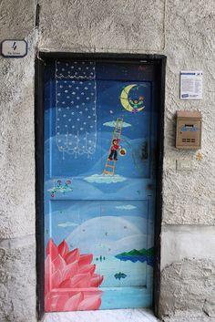 Decorated door in Valloria, Italy - photo by Lorenzo, via Flickr