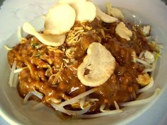 Ketoprak is bean sprouts, tofu, rice noodle and crackers in peanut sauce - indonesian food
