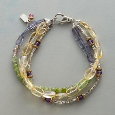 """SUNLIGHT AND SKY BRACELET--One strand is dedicated to sunny citrine, the other two bring iolite, chrysoprase, amethyst, pink topaz and sterling silver into the mix. Lobster clasp. Handmade in USA exclusively for us. 7-1/2"""" to 8-1/2""""L."""