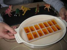 Insects in amber - a simple dinosaur themed party food idea. Orange Jelly and Sultanas for insects.