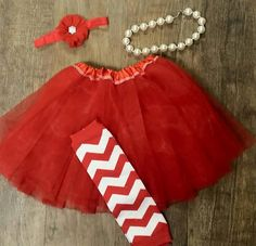 Check out this item in my Etsy shop https://www.etsy.com/listing/263912812/red-tutu-set-w-legwarmers-necklace-and