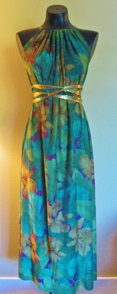 One of a kind teal, green, purple, and gold Tropical Print Maxi SACKdress. This dress can be worn in more than 20 different ways, and one size fits all!  #maxi #maxidress #sackdress #sack #long #printed #prints #jungle #floral #leaves #green #gold  #onesize #onesizefitsall #etsy #custom #eco #ecofashion #economical #plussize #maternity #beach #coverup #greatgifts #straps